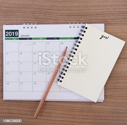 1162245415 istock photo close up soft focus on  pencil over calendar with blank mini notebook page on wood desk for make to do list of 2019 goal , work life balance concept 1086239300