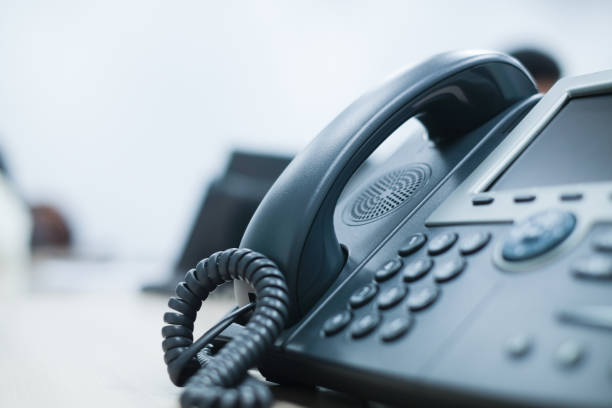 close up soft focus on telephone devices at office desk for customer service support concept close up soft focus on telephone devices at office desk for customer service support concept phone stock pictures, royalty-free photos & images