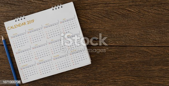 istock close up soft focus on yellow pencil over calendar 2018 at office desk with top view for make appointment or remember important event on date concept 1071000706