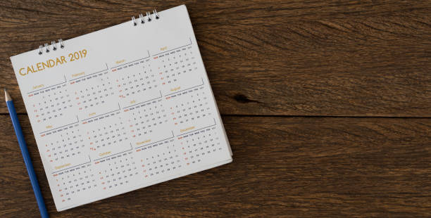 close up soft focus on yellow pencil over calendar 2018 at office desk with top view for make appointment or remember important event on date concept - calendar imagens e fotografias de stock