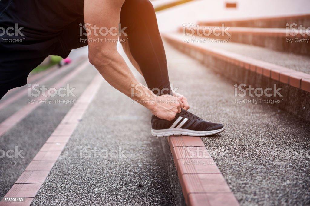 Close up sport man exercising at outdoor city