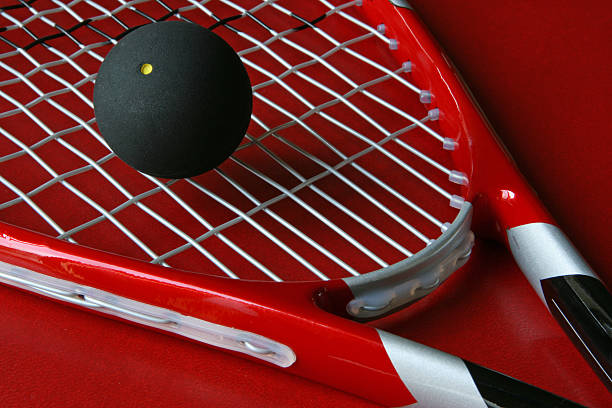 Close up squash racket and ball  stock photo