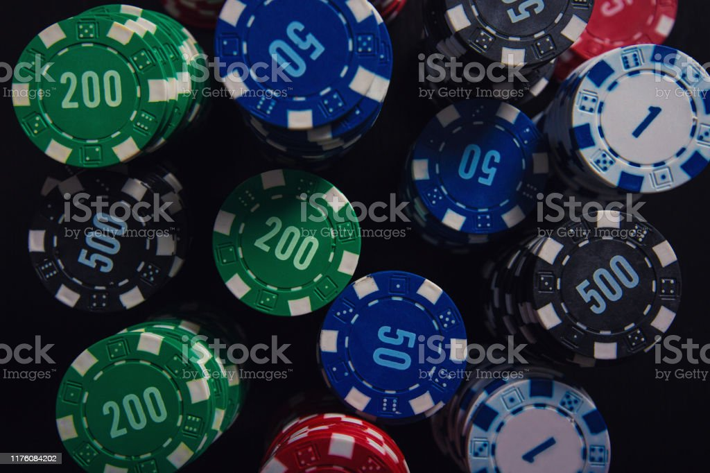 Close Up Stack Of Different Colored Poker Chips Of Diverse Value