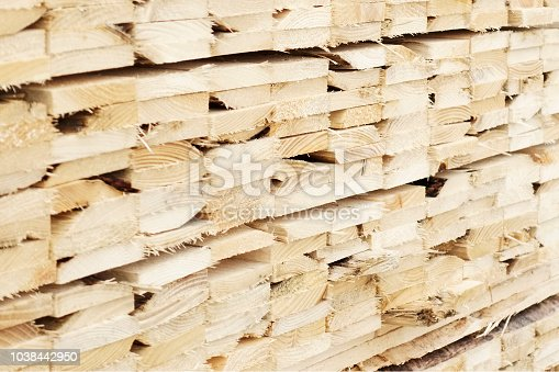 istock Close up stacked wood planks at sawmill for biomass fuel 1038442950