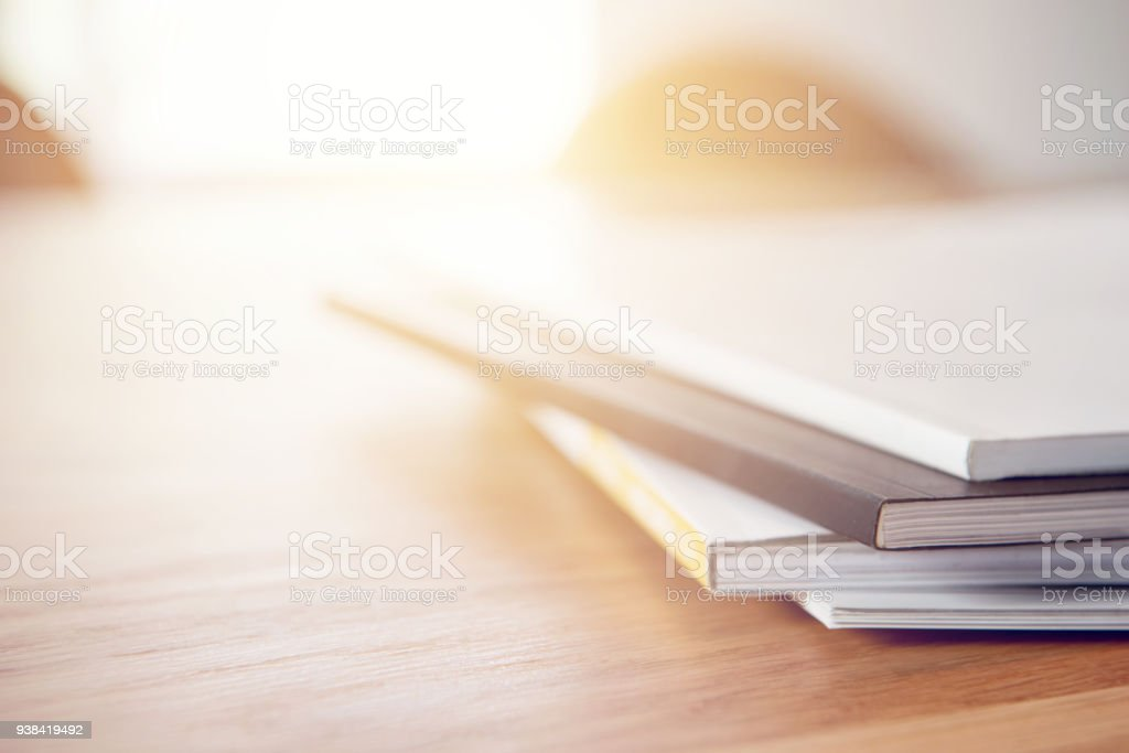 Cтоковое фото Close up stacking magazine place on table background, copy space