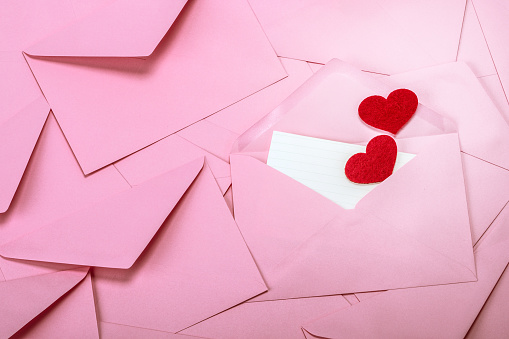 Close Up Stacking Of Pink Envelopes And Mail Letter Paper And Red Herat The Romance Love Letter Concept For Holiday Valentines Day Greeting Card Concept Stock Photo - Download Image Now