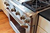 Close up stainless steel stove with oven