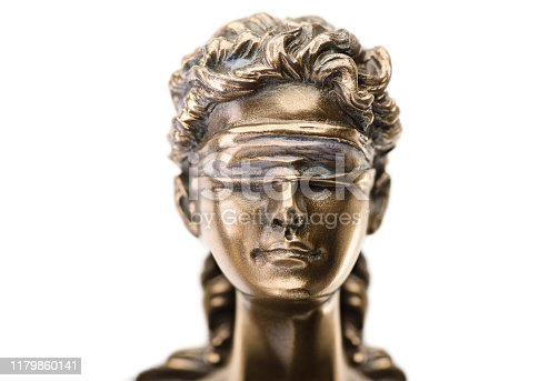 istock Close up statue of justice isolated on white background 1179860141