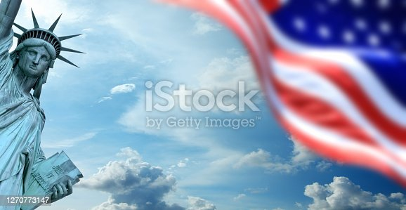 Conceptual image of waving American flag and Statue of Liberty over sky in New York
