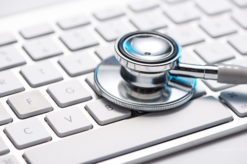 istock Close up stethoscope on a keyboard 499265626