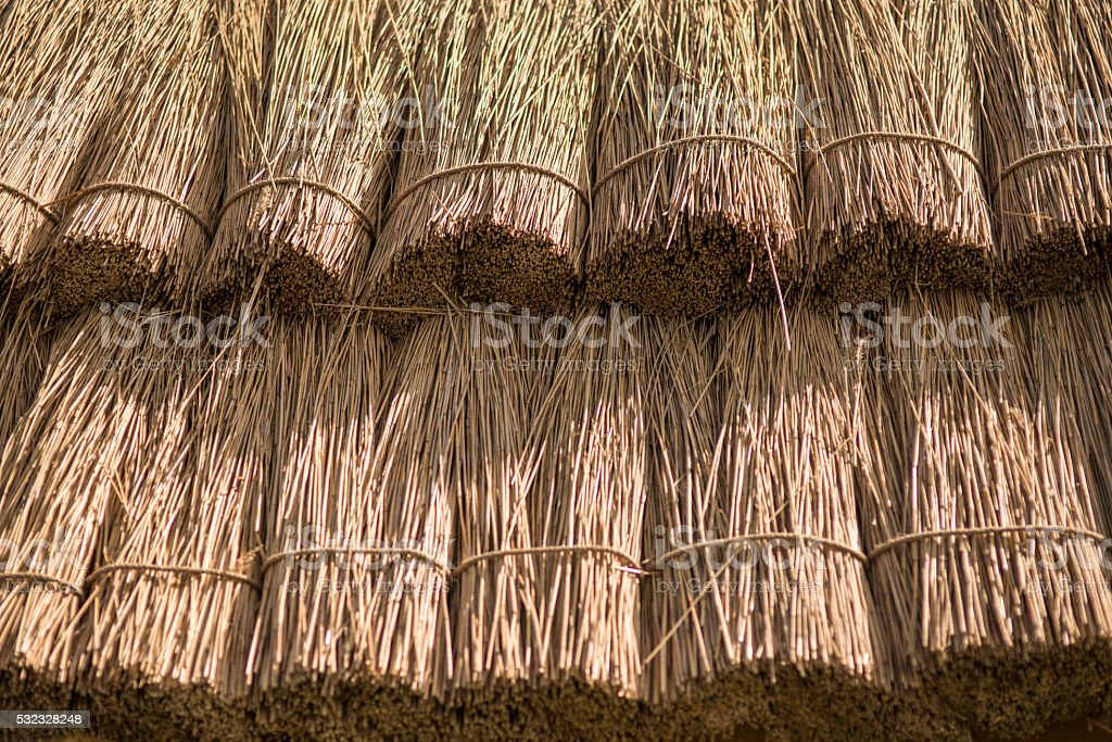 Close up straw background. Texture of thatch roof stock photo