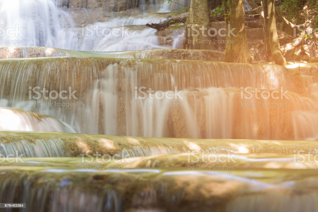 Close up stream waterfall in tropical deep forest stock photo