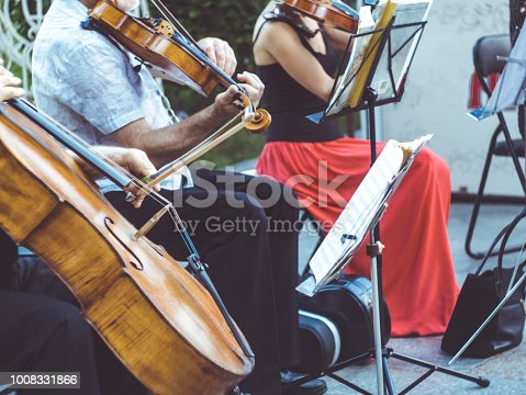 close up street musician playing violin instrument jazz music performer