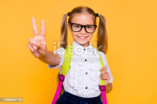 1176772377 istock photo Close up studio photo portrait of sweet lovely intelligent with beaming smile long straight hairstyle wearing white daughter making giving v-sign isolated bright vivid background 1058004178