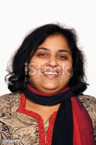 Close up studio shot of Indian woman smiling