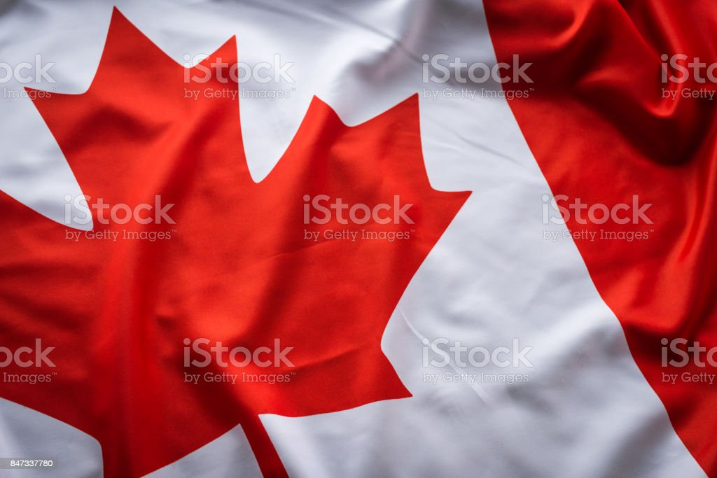 Close up studio shot of real Canadian flag stock photo