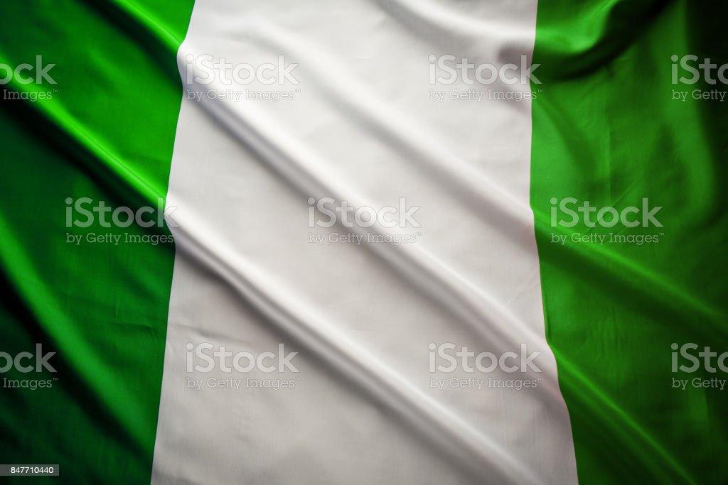 Cierre toma de estudio de la bandera real nigeriano - foto de stock