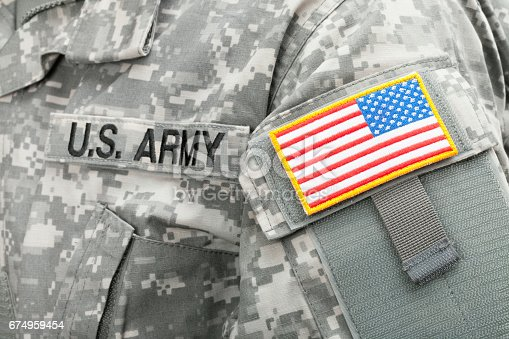 istock Close up studio shot of USA flag and U.S. ARMY patch on solders uniform 674959454