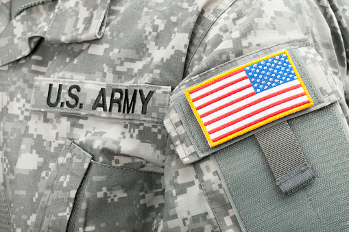 Studio shot of USA flag and U.S. ARMY patch on American solders uniform