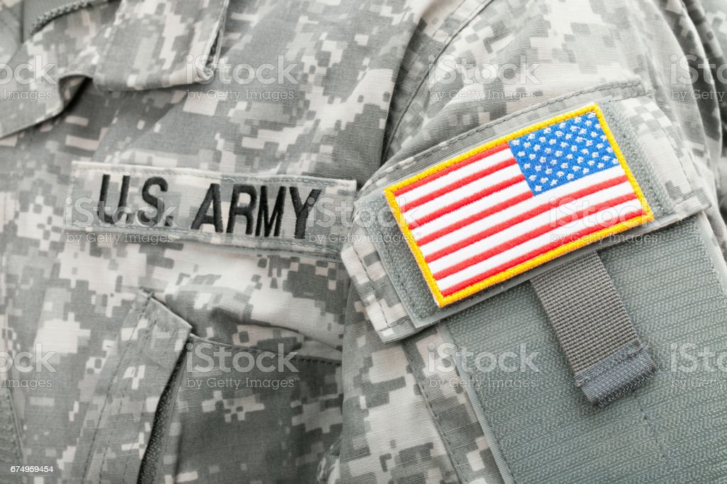 Close up studio shot of USA flag and U.S. ARMY patch on solders uniform stock photo