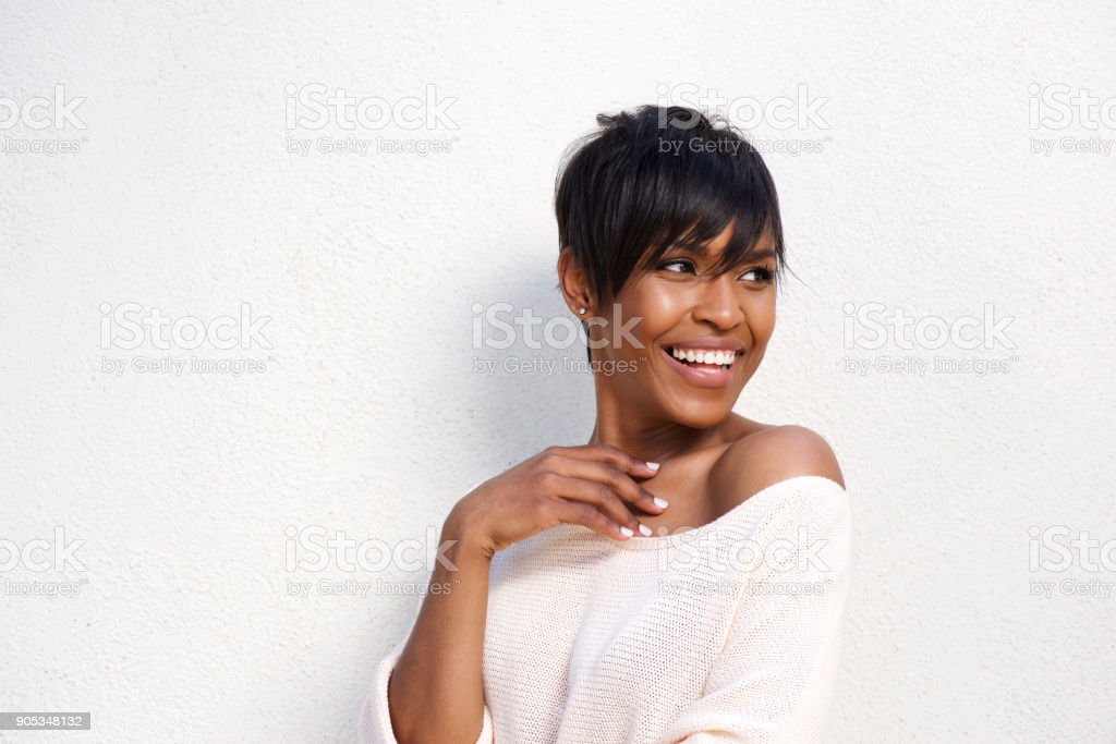 Close up stylish young black female model against white background stock photo