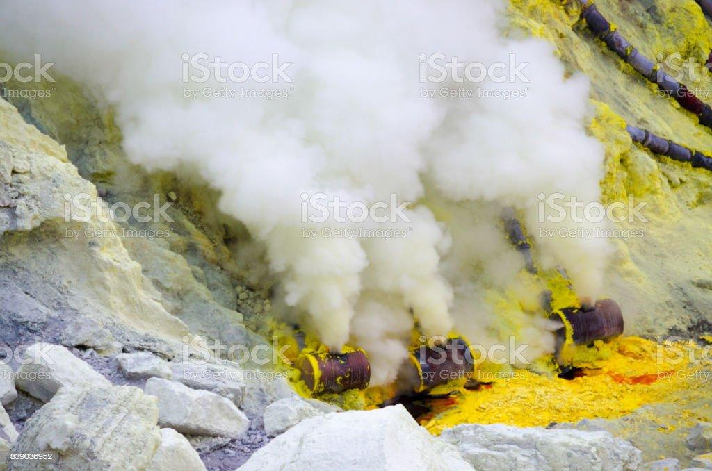Close up sulfur mining at Kawah Ijen, East java, Indonesia. stock photo