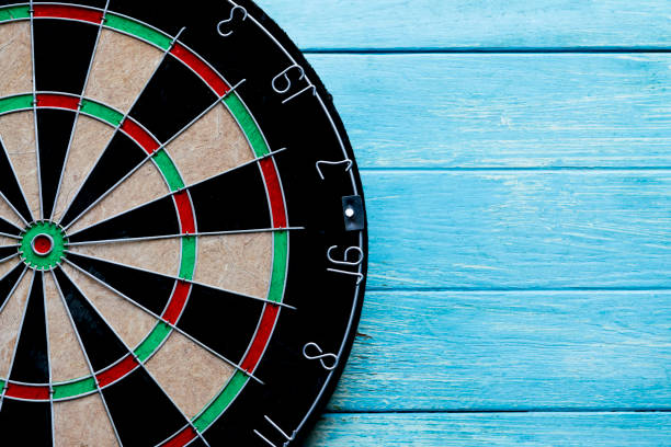 close up target dart board center point on the table, head to target marketing and business concept stock photo