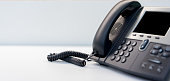 close up telephone VOIP technology standing on office desk in monitoring room for network operation center job concept