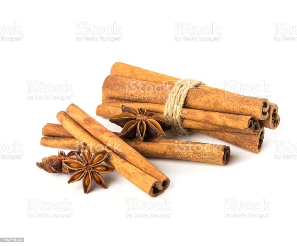 Close up the brown cinnamon stick with star anise spice isolated on white background , overhead and top view royalty-free stock photo