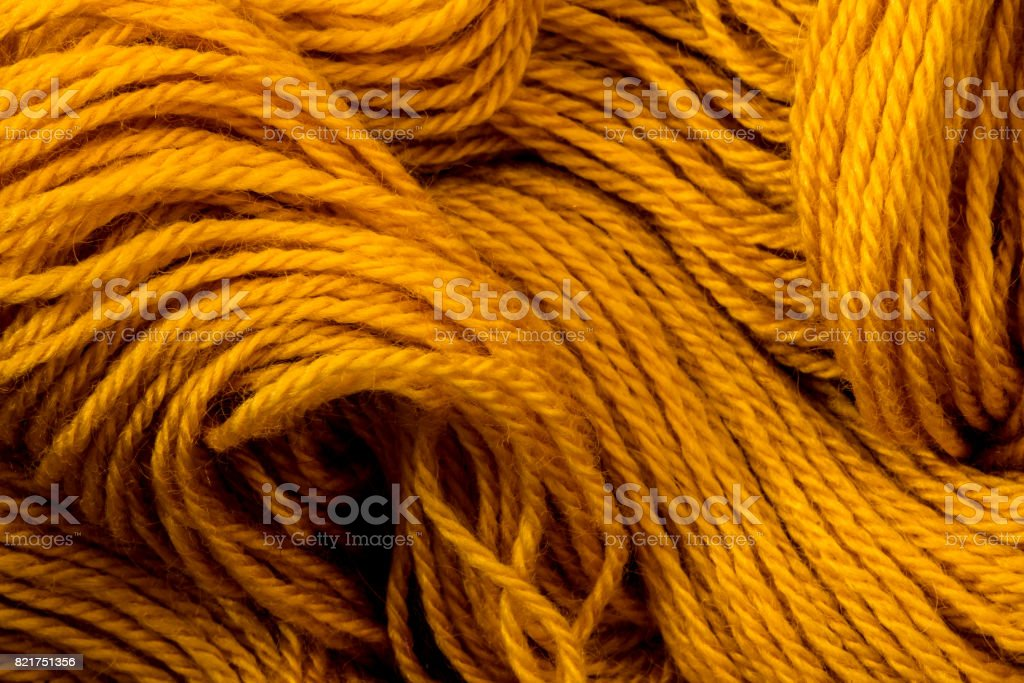 Close up the golden yellow yarn thread as abstract  background stock photo