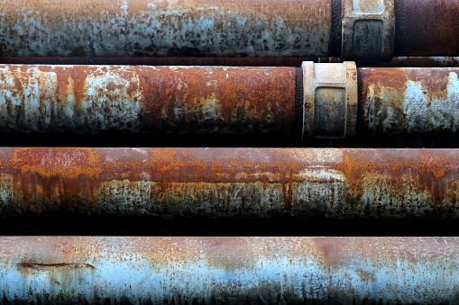 Close up. The old rusted steel pipes.