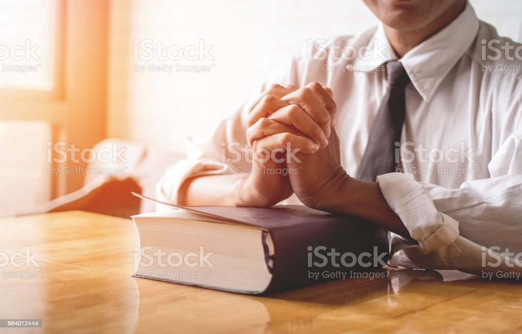 close up, the pastor laid hands on the black book of the Bible, Buddhist, Catholic, Christian, prayer, and pray for blessings from God, all people are safe from harm. stock photo