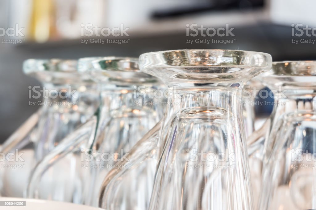 Close up the stacks of empty glasses with blurred background stock photo