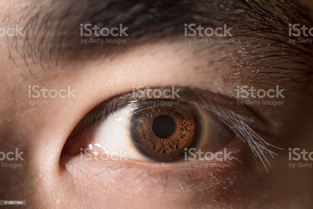 Close up to brown eye Asian man stock photo