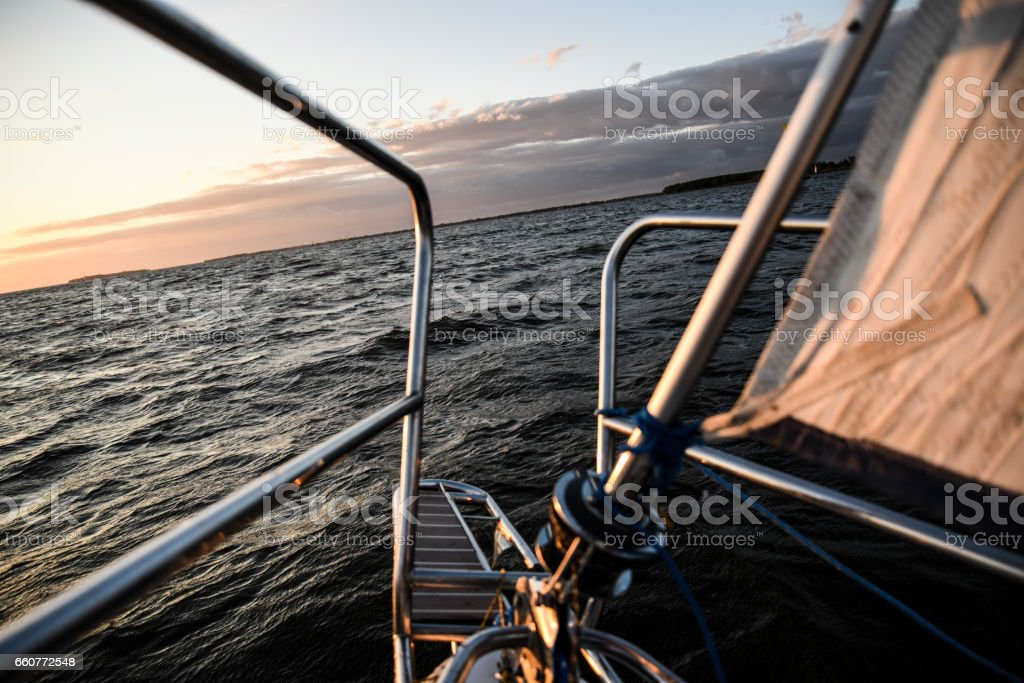 Close up to elements of sailboat, sailing on a bay. stock photo
