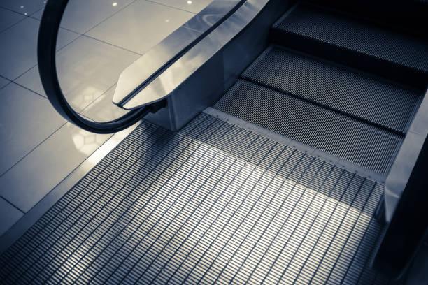 close up to escalator yellow and gray steel line. - escalator foto e immagini stock