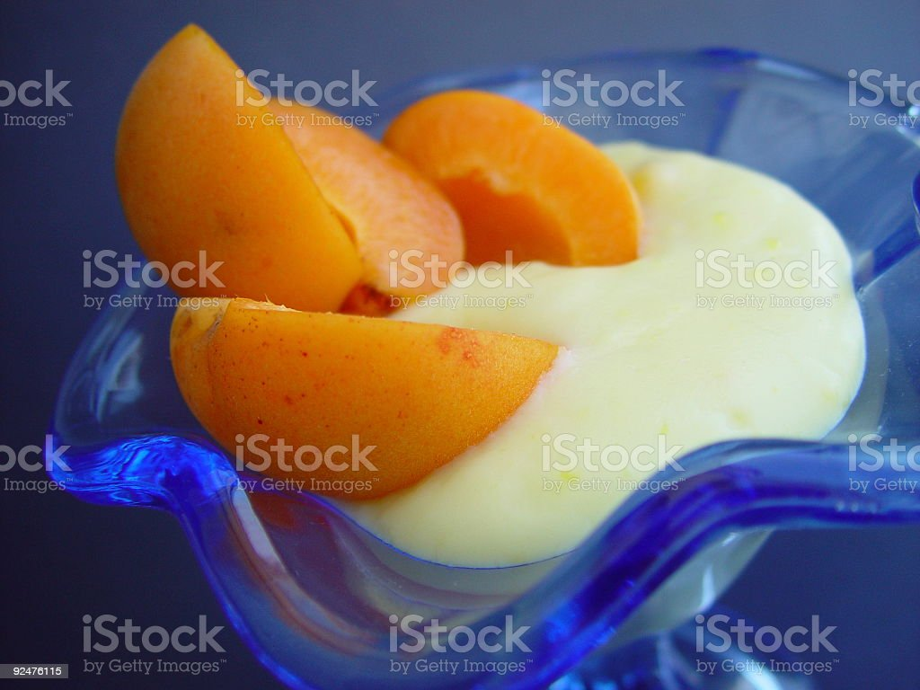 Close up to fresh apricots and cream royalty-free stock photo