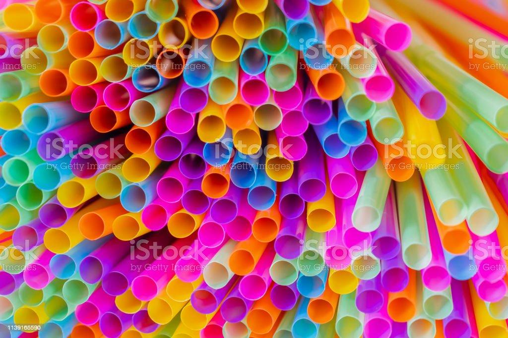 Close up to plenty colorful straws background