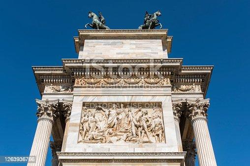 Close up to the bas-reliefs on the Arch of Porta Sempione (Sempione Gate) also know as Porta della Pace (Peace Gate) at Milano city, Italy.