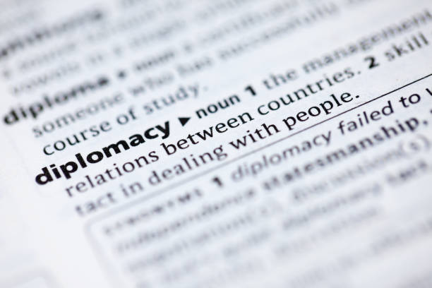 Close up to the dictionary definition of word Diplomacy Close up to the dictionary definitions diplomacy stock pictures, royalty-free photos & images