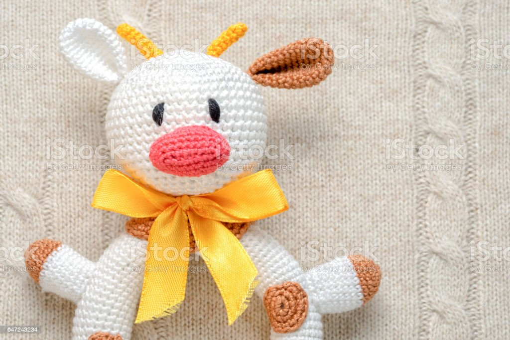 close up top view of amigurumi crochet bull toy stock photo