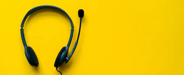 close up top view of headset of call center and voip for communication technology on yellow background for network operation job concept - słuchawka telefoniczna zdjęcia i obrazy z banku zdjęć