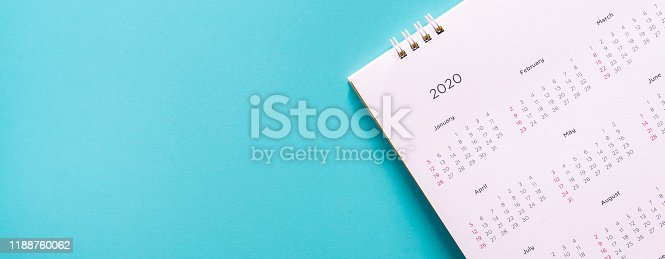 close up top view on white calendar December 2020 schedule on blue color panoramic background to make appointment meeting or manage timetable each day for design planning work and life concept