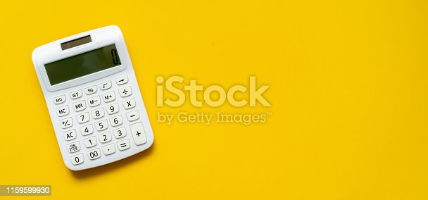 close up top view white calculator on yellow background with copyspace for counting and planning about monthly expenses at home for retirement lifestyle concept