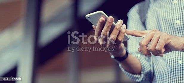 istock close up traveler backpacker man hand holding smartphone for checking flight online or search information on browser website about plan trip at destination , lifestyle concept 1041155588