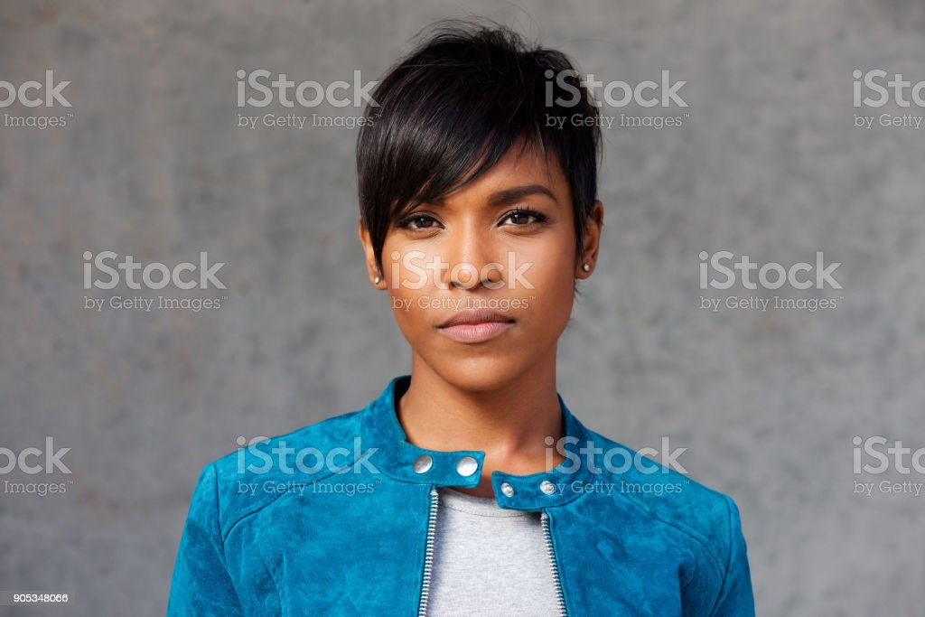 Close up trendy young black woman with blue jacket stock photo