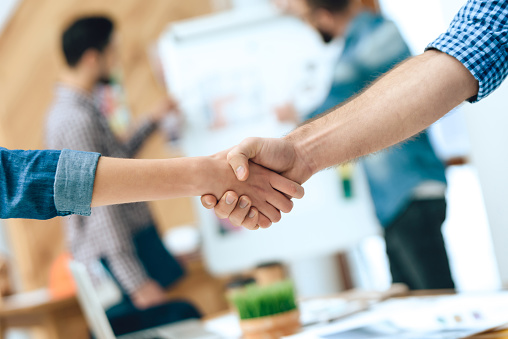912867216 istock photo Close up two designers architects shaking hands. 955045522