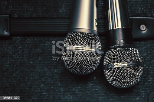 istock close up two microphone for duo sing a song concept 936841370