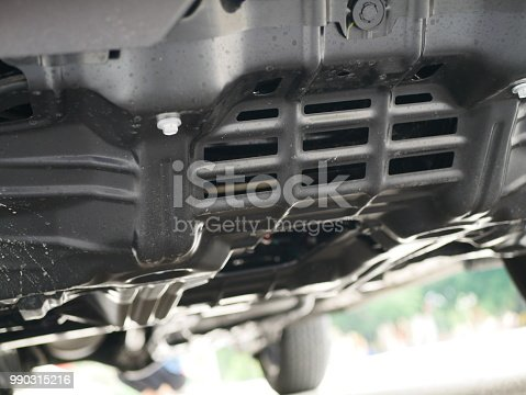 853517784 istock photo Close up under Underneath a car 990315216