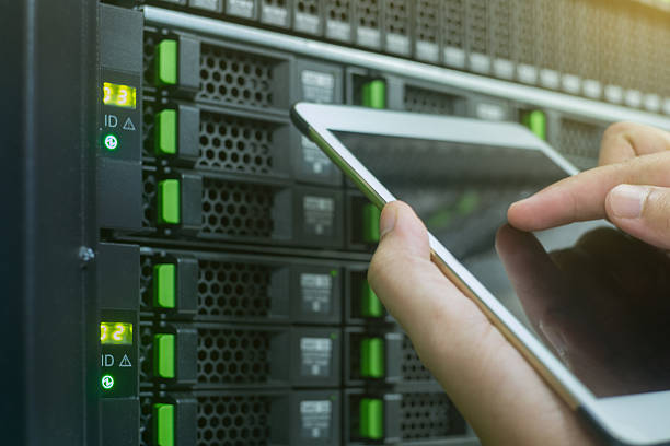 close up use tablet in data center stock photo